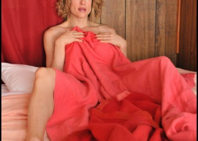 Delia in rose-colored blankets